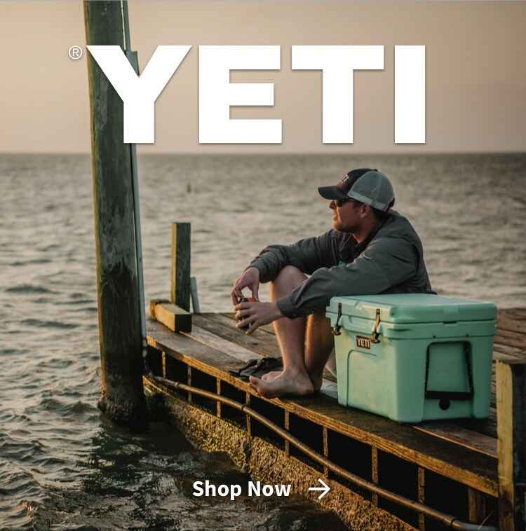 Man sitting on lake pier with YETI cooler